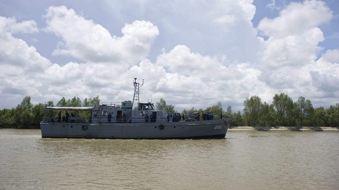 A Myanmar navy ship is seen near Haigyi island, NgaPuTaw Township, Irrawaddy Division on May 30, 2015. AFP