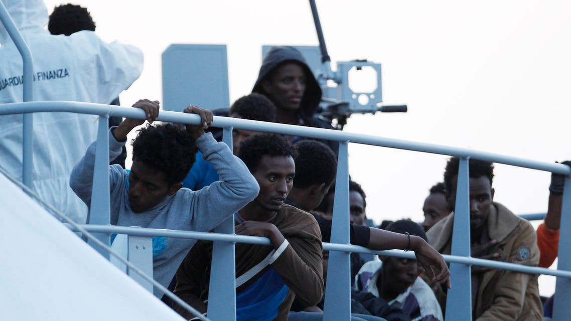 Rescued migrants wait to disembark in the Island of Lampedusa, southern Italy, Thursday, May 14, 2015.