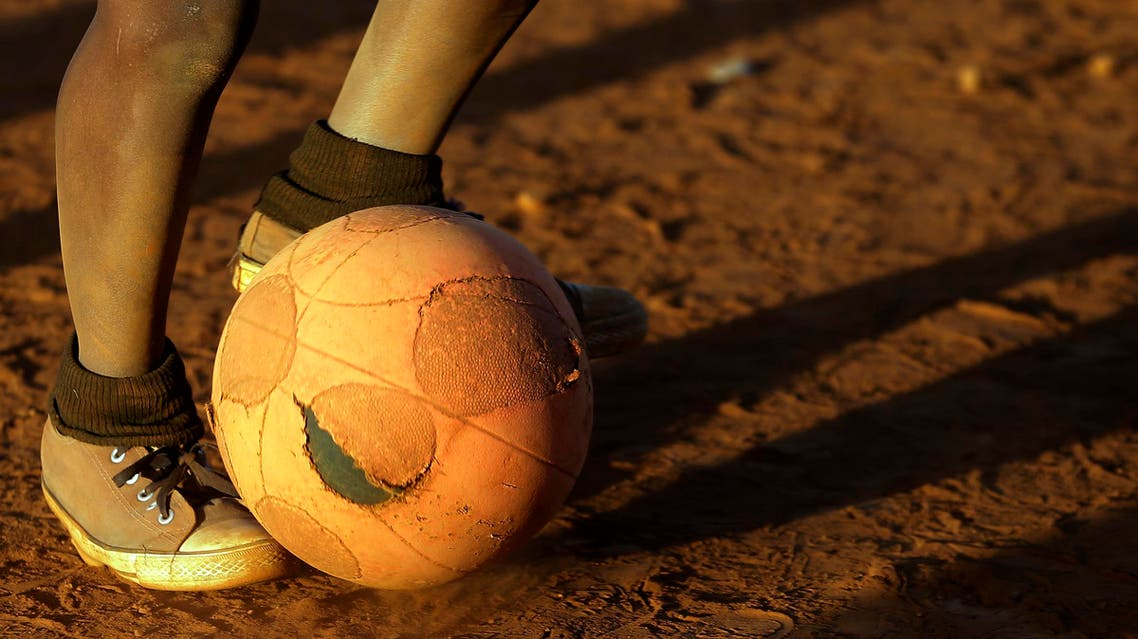 A young boy controls the ball while playing soccer with others, on a dusty field in Thokoza township east of Johannesburg, South Africa, Thursday, May 28, 2015. (File: AP)