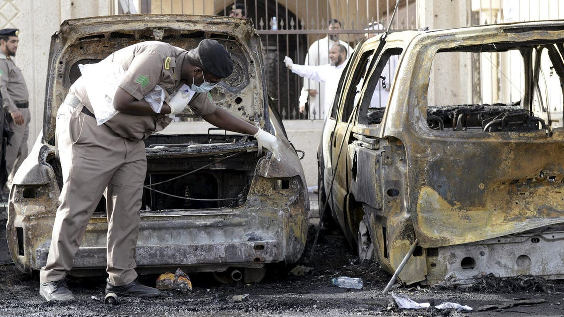 Policeman carries out an inspection after a car exploded near a Shi'ite mosque in Saudi Arabia's Dammam. (Reuters)