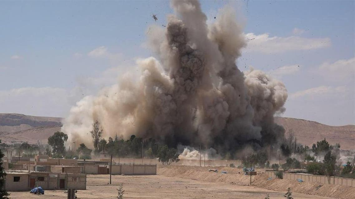 An image made available by militant media outlet Welayat Homs on May 30, 2015, allegedly shows the prison of the Syrian city of Palmyra being blown up by ISIS militants. (AFP)