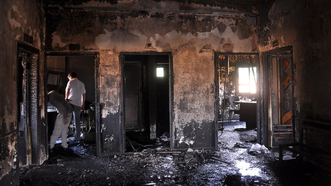 People inspect the damage in the Maysalun clinic where a fire broke out after a fuel tank exploded on May 31, 2015 in the northeastern city of Qamishli. (AFP)