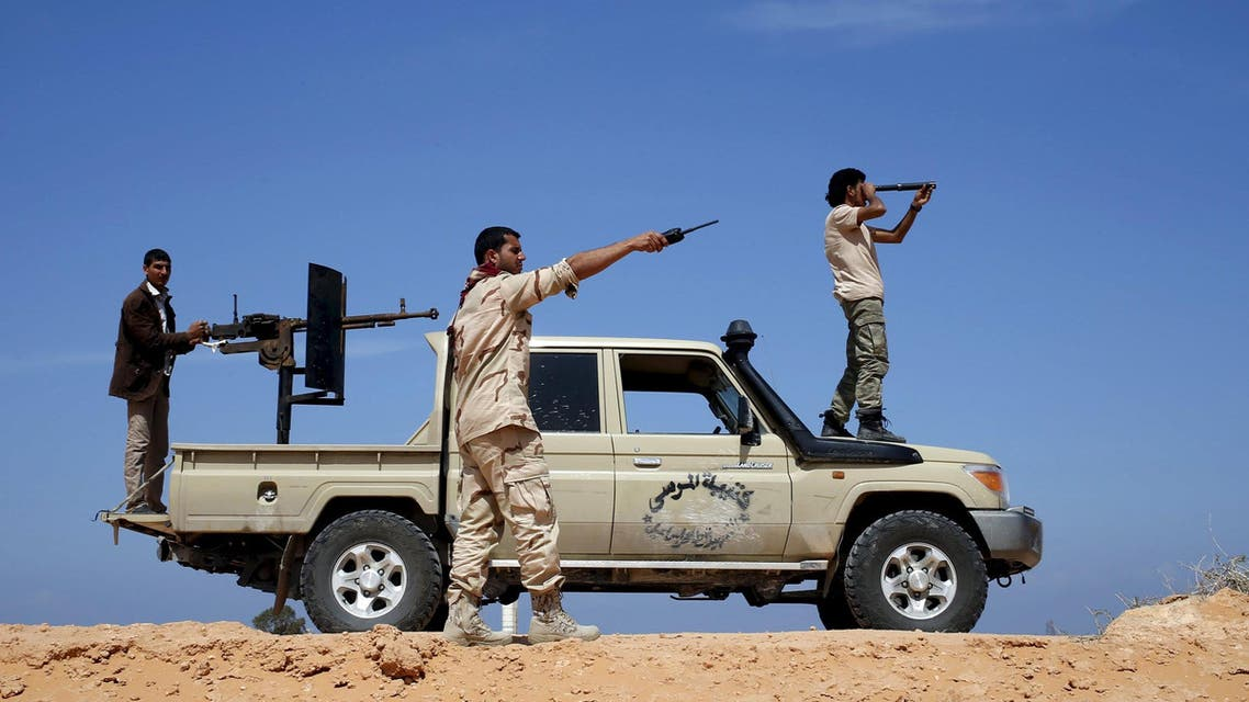 Libya Dawn fighters look at ISIS militant positions near Sirte March 19, 2015. (Reuters)