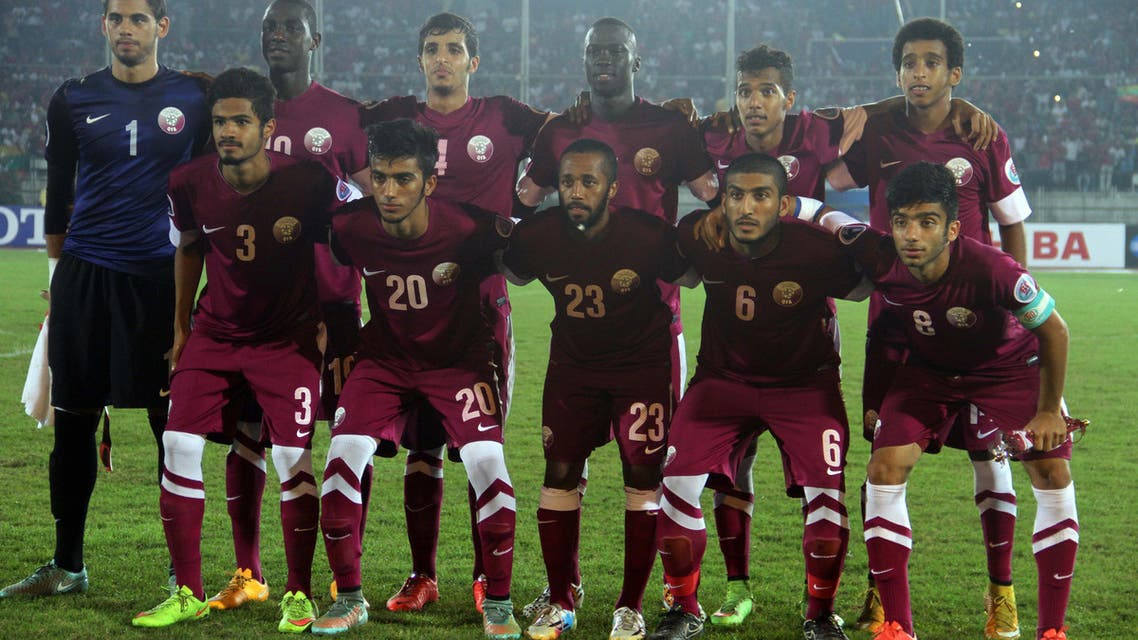 Players of Qatar Asian Football Confederation (AFC) U-19 team pose for a photo before their soccer match with Myanmar at Thuwunna stadium Monday, Oct 20, 2014, in Yangon, Myanmar. Qatar beat Myanmar 3-2. (AP Photo/Khin Maung Win)