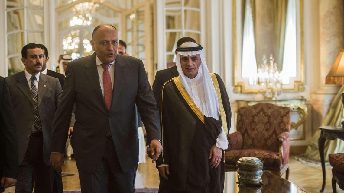 Egyptian Foreign Minister Sameh Shoukri (C-L) and his newly appointed Saudi counterpart, Adel al-Jubeir, arrive for a joint press conference following their meeting in Cairo on May 31, 2015. AFP