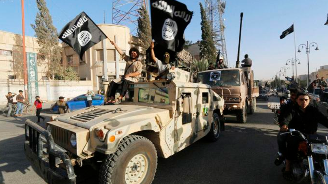 ISIS militants seen parading in a Humvee (Photo courtesy of Twitter)