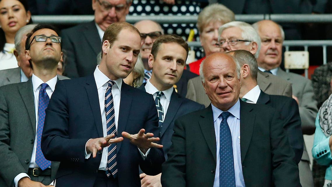 Britain's Prince William, left, gestures as he stands with FA chairman Greg Dyke after the English FA Cup final soccer match between Aston Villa and Arsenal at Wembley stadium in London, Saturday, May 30, 2015. AP