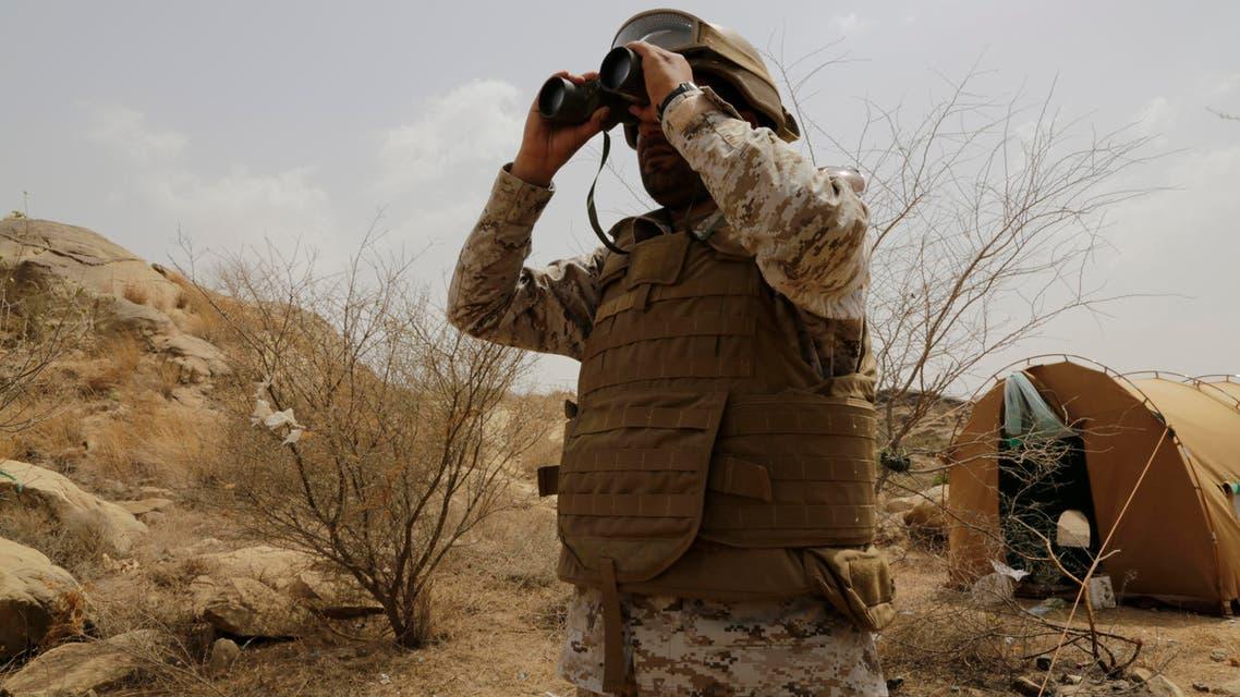 A Saudi soldier looks with binoculars toward the border with Yemen in Jazan, Saudi Arabia, Monday, April 20, 2015. The Saudi air campaign in Yemen is now in its fourth week. (AP Photo/Hasan Jamali)