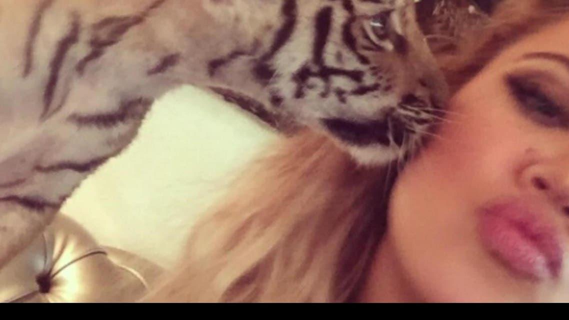 Khloe Kardashian's tiger cub selfie has raised a few eye brows citing the captivity of a wild animal. (Photo courtesy: Instagram)