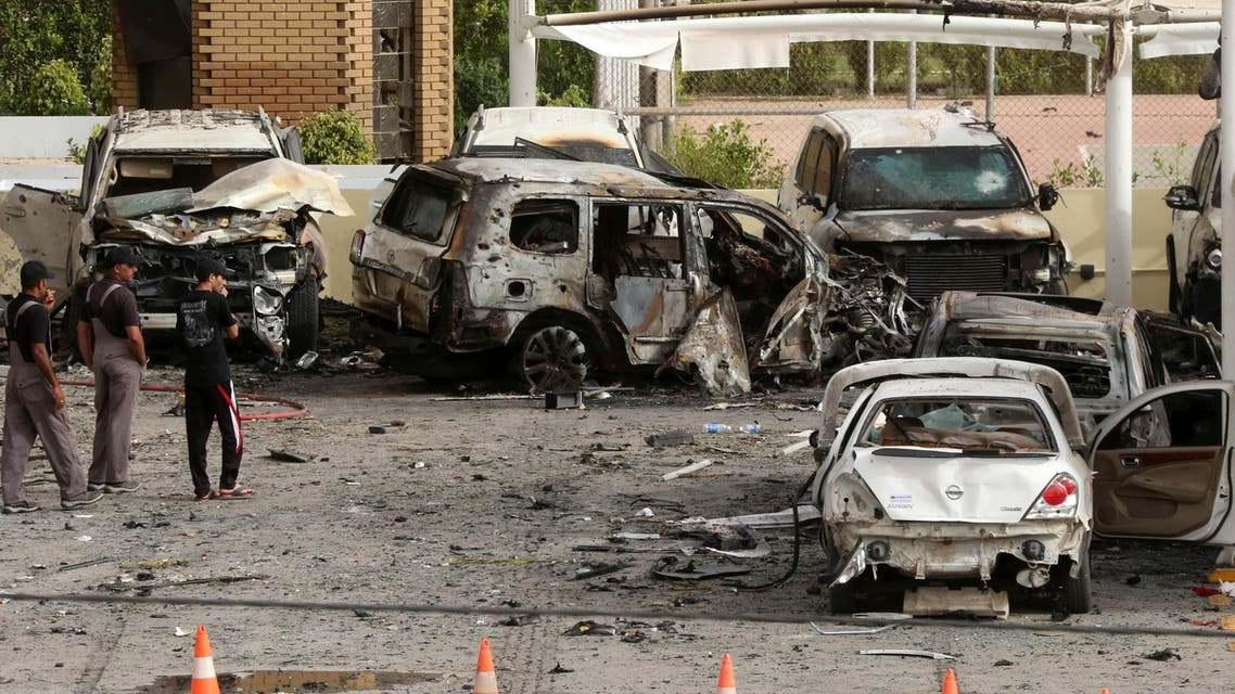 Civilians and security forces inspect the aftermath of a car bomb attack in the parking lot of Babil hotel in Karrada neighborhood, Baghdad, Iraq, Friday, May 29, 2015. Two separate car bombs inside parking lots of two downtown hotels have killed and wounded civilians late Thursday, authorities said. (AP Photo/Hadi Mizban)