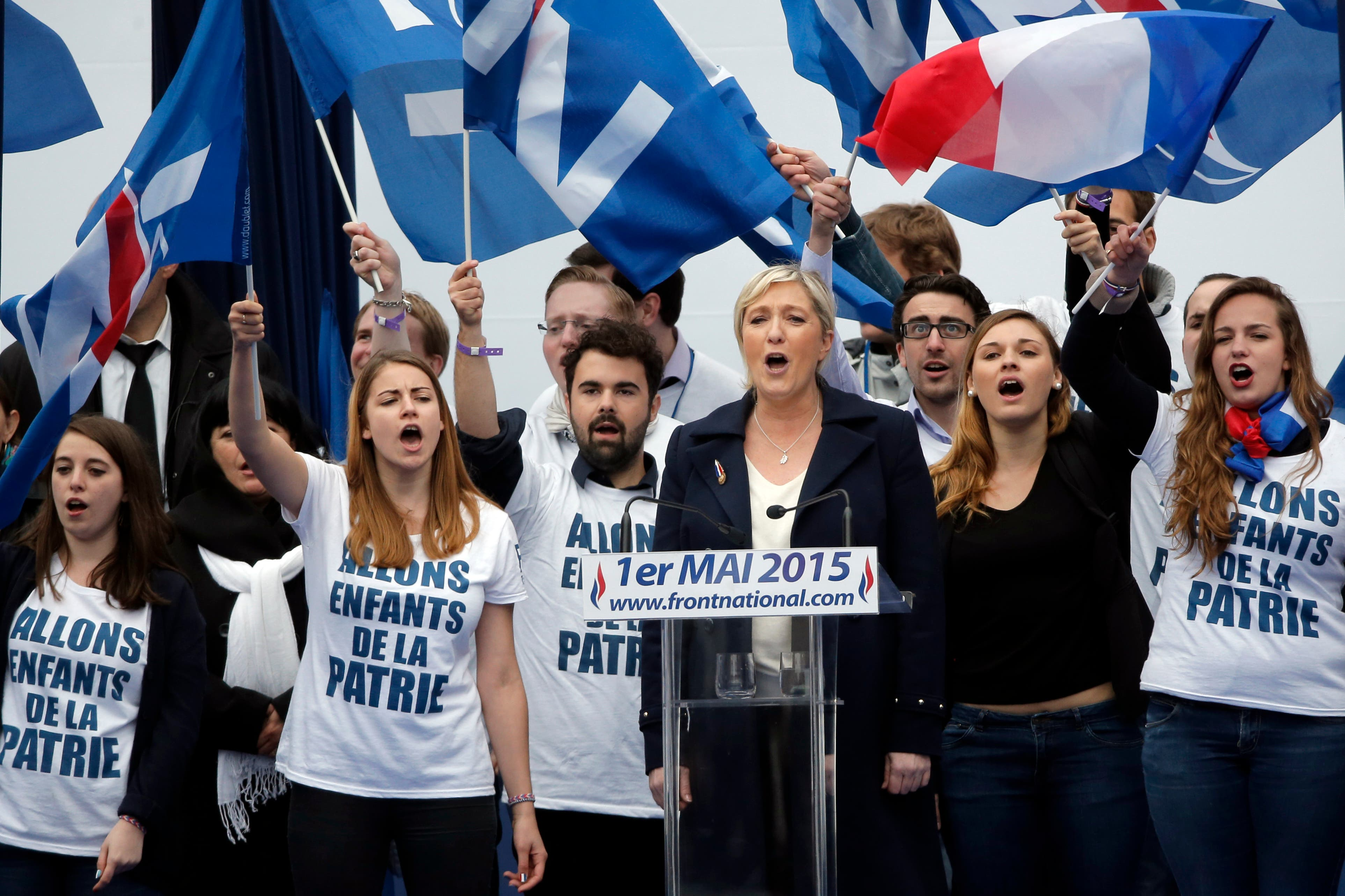 France's far-right National Front president Marine Le Pen, center, surrounded by supporters. (File photo:AP