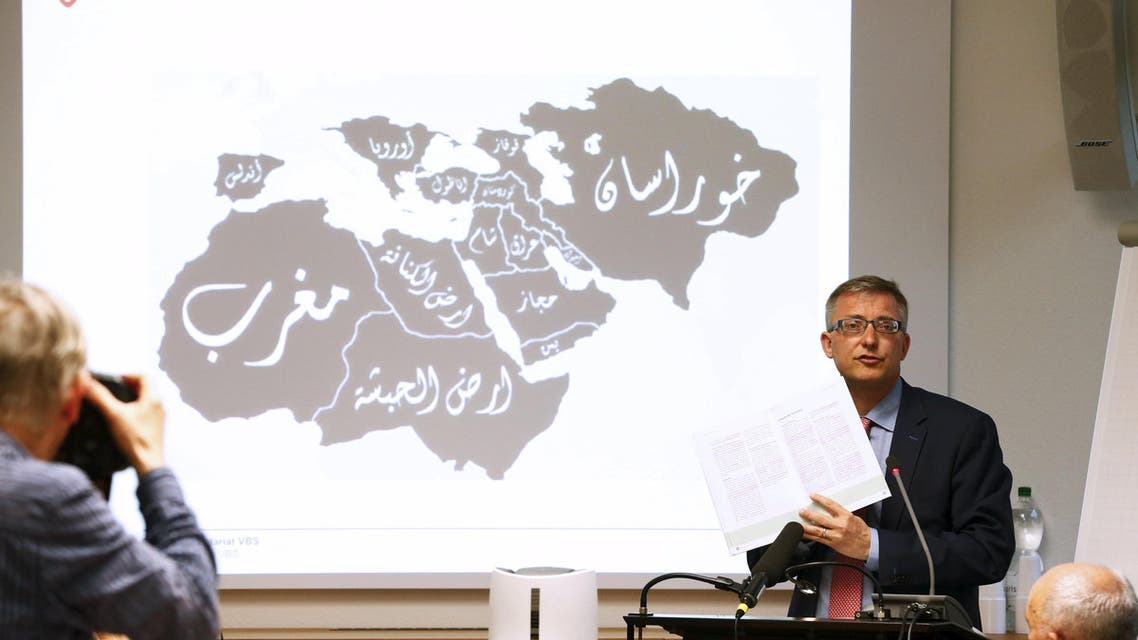 Swiss Federal Intelligence Service NDB director Markus Seiler speaks in front of a map showing the territories where the Islamic State has presence. (File: Reuters)