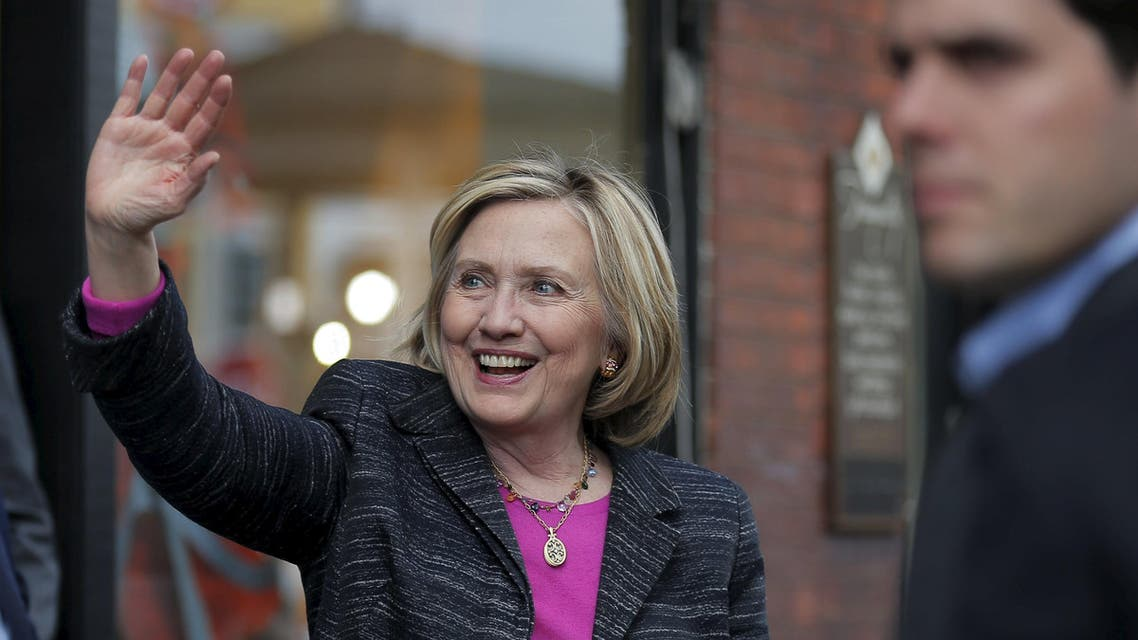 Democratic presidential candidate Hillary Clinton waves to supporters gathered outside after she spoke at the Water Street Bookstore in Exeter, New Hampshire May 22, 2015. REUTERS/Brian Snyder