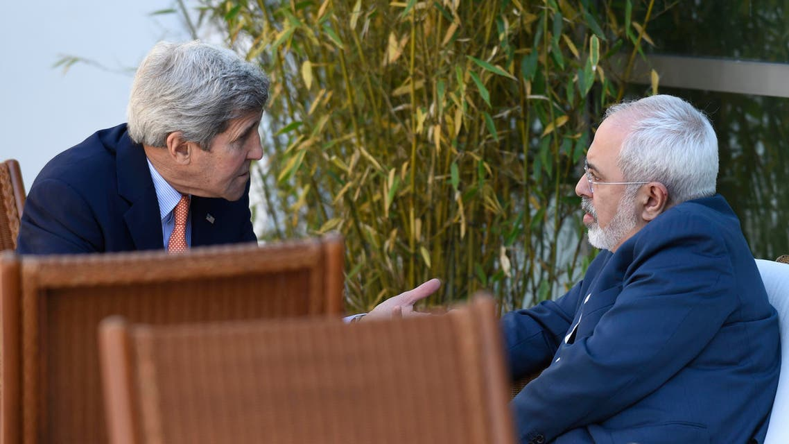 U.S. Secretary of State John Kerry, left, talks with Iranian Foreign Minister Mohammad Javad Zarif, in Geneva, Switzerland, Saturday, May 30, 2015. Top U.S. and Iranian diplomats are gathering in Geneva this weekend, (AP)
