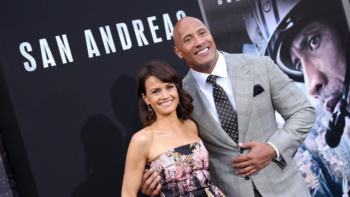 """Carla Gugino, left, and Dwayne Johnson arrive at the premiere of """"San Andreas"""" at the TCL Chinese Theatre on Tuesday, May 26, 2015, in Los Angeles. (Photo by Richard Shotwell/Invision/AP)"""