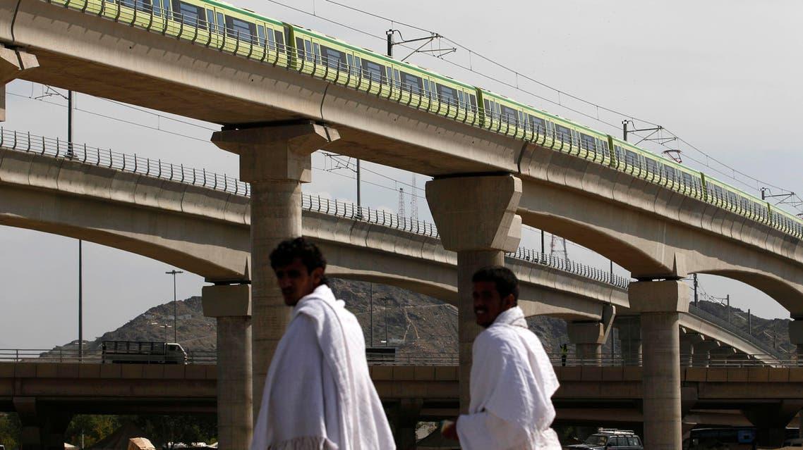 A Mecca Metro train passes over Muslim pilgrims' heads towards Mina ahead of the hajj main ritual at Mount Arafat outside Mecca, Saudi Arabia