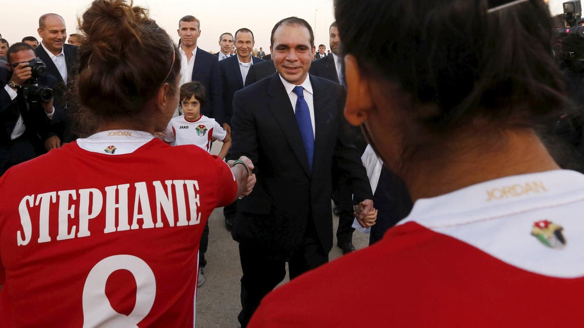 Members of the Jordanian women's national soccer team welcome Jordan's Prince Ali bin Al Hussein (C), upon his arrival at Queen Alia International Airport in Amman, after his return from participating in the International Federation of Association Football (FIFA) elections on Friday, May 31, 2015. REUTERS/ Muhammad Hamed