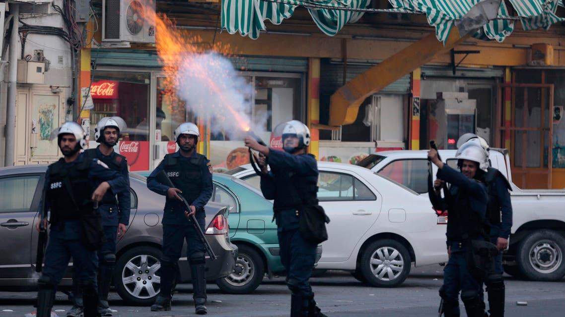 Riot police fire tear gas canisters toward Bahraini anti-government protesters during clashes in Daih, Bahrain, on Friday, March 13, 2015. Protesters marched in opposition areas nationwide to mark four years since Saudi and Emirati forces arrived to help the Bahraini government crush a pro-democracy uprising. Demonstrators in Daih demanded freedom for jailed relatives and political leaders before the march devolved into clashes between riot police firing tear gas and shotgun pellets and youths throwing petrol bombs, steel bars and stones. (AP Photo/Hasan Jamali)