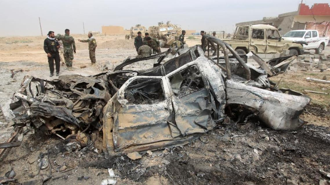 Iraqi Shiite fighters stand at the site of a car bomb on March 12, 2015 in a suburb of Tikrit during a military operation to retake the city from ISIS. (File Photo: AFP)