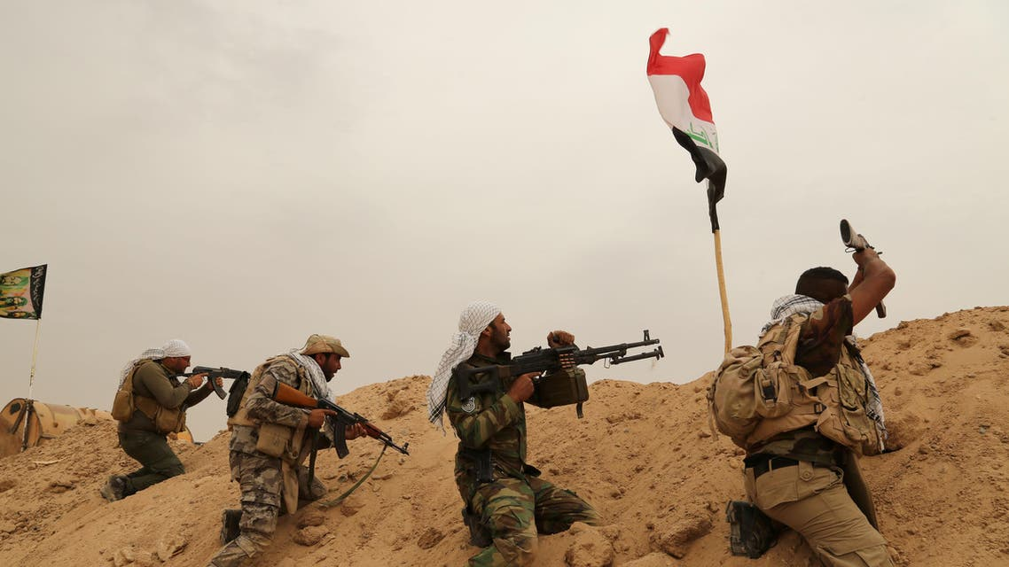 Fighters from Badr Brigades Shiite militia clash with Islamic State group militants at the front line on the outskirts of Fallujah, Anbar province, Iraq, Monday, June 1, 2015. Three Islamic State suicide bombers targeted a police base in the Tharthar area north of Ramadi, some 30 miles (48 kilometers) west of Fallujah, with explosives-laden Humvees on Monday, killing at least 41 police and Shiite militiamen, officials said. (AP Photo/Hadi Mizban)