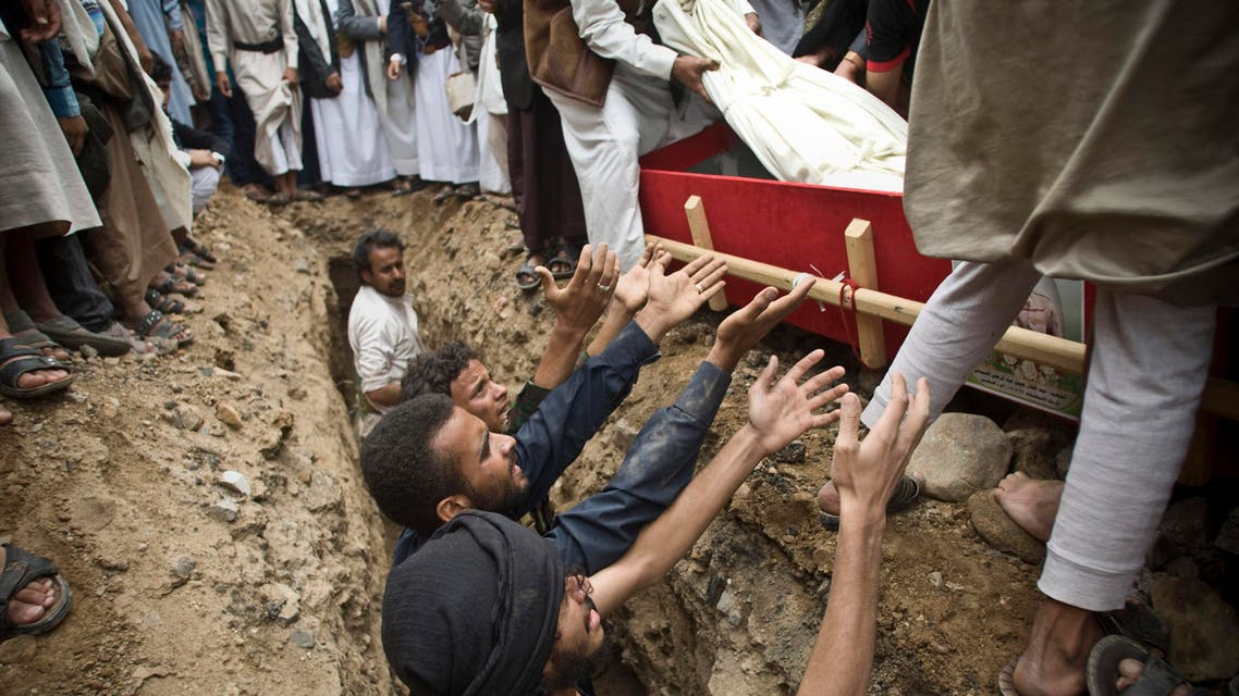 Shiite rebels known as Houthis bury a fellow Houthi who was killed in a Saudi-led airstrike during his funeral in Sanaa, Yemen, Monday, May 25, 2015. A United Nations-sponsored peace conference that was to take place at the end of the month has been indefinitely postponed, senior Yemeni politicians said. The latest setback came as jets from the Saudi-led coalition on Monday pounded Shiite rebel positions in the capital and across the country. (AP Photo/Hani Mohammed)