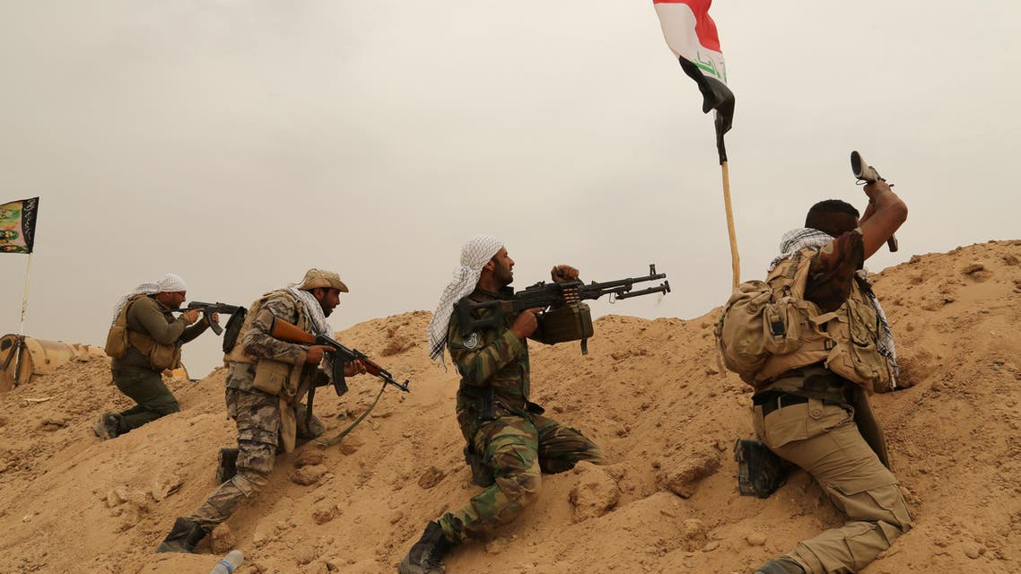 Fighters from Badr Brigades Shiite militia clash with Islamic State group militants at the front line on the outskirts of Fallujah, Anbar province, Iraq, Monday, June 1, 2015. (AP))