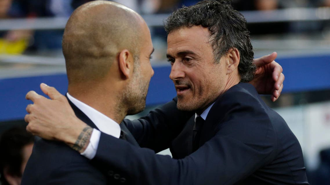 Barcelona's head coach Luis Enrique, right, welcomes Bayern's head coach Pep Guardiola prior to the Champions League semifinal first leg soccer match between Barcelona and Bayern Munich at the Camp Nou stadium - AP