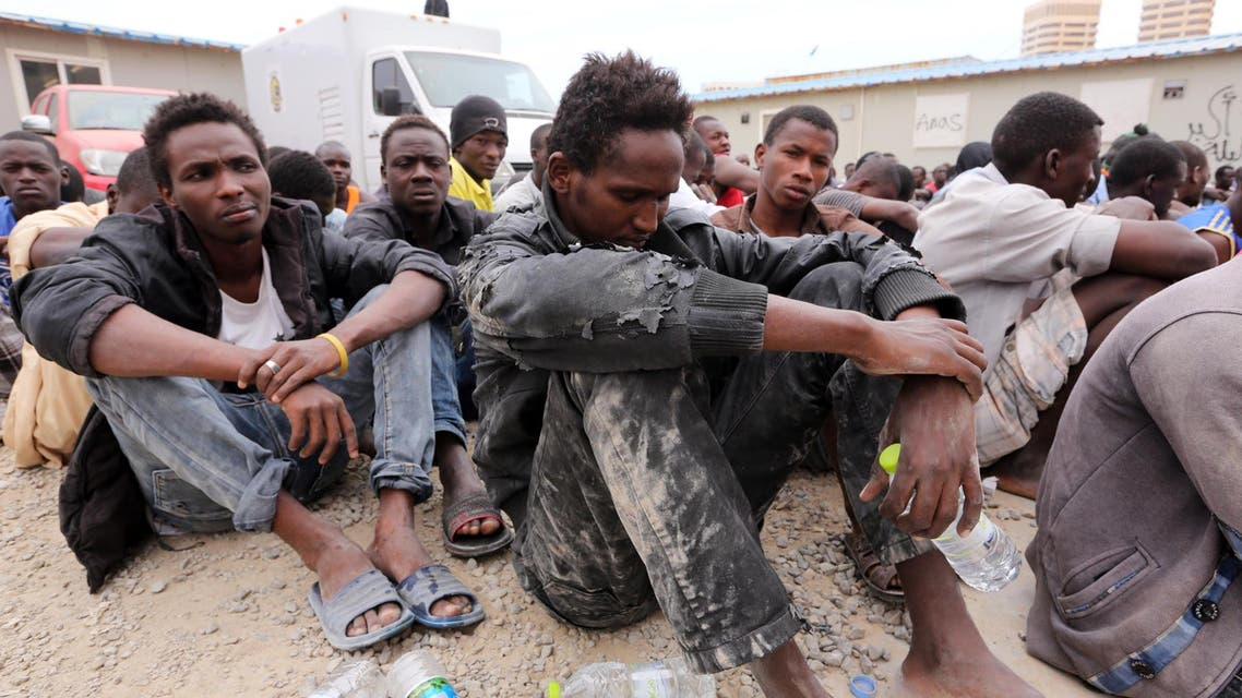 Migrants from sub-Saharan Africa rest inside a detention center in the Libyan capital Tripoli on June 4, 2015. AP
