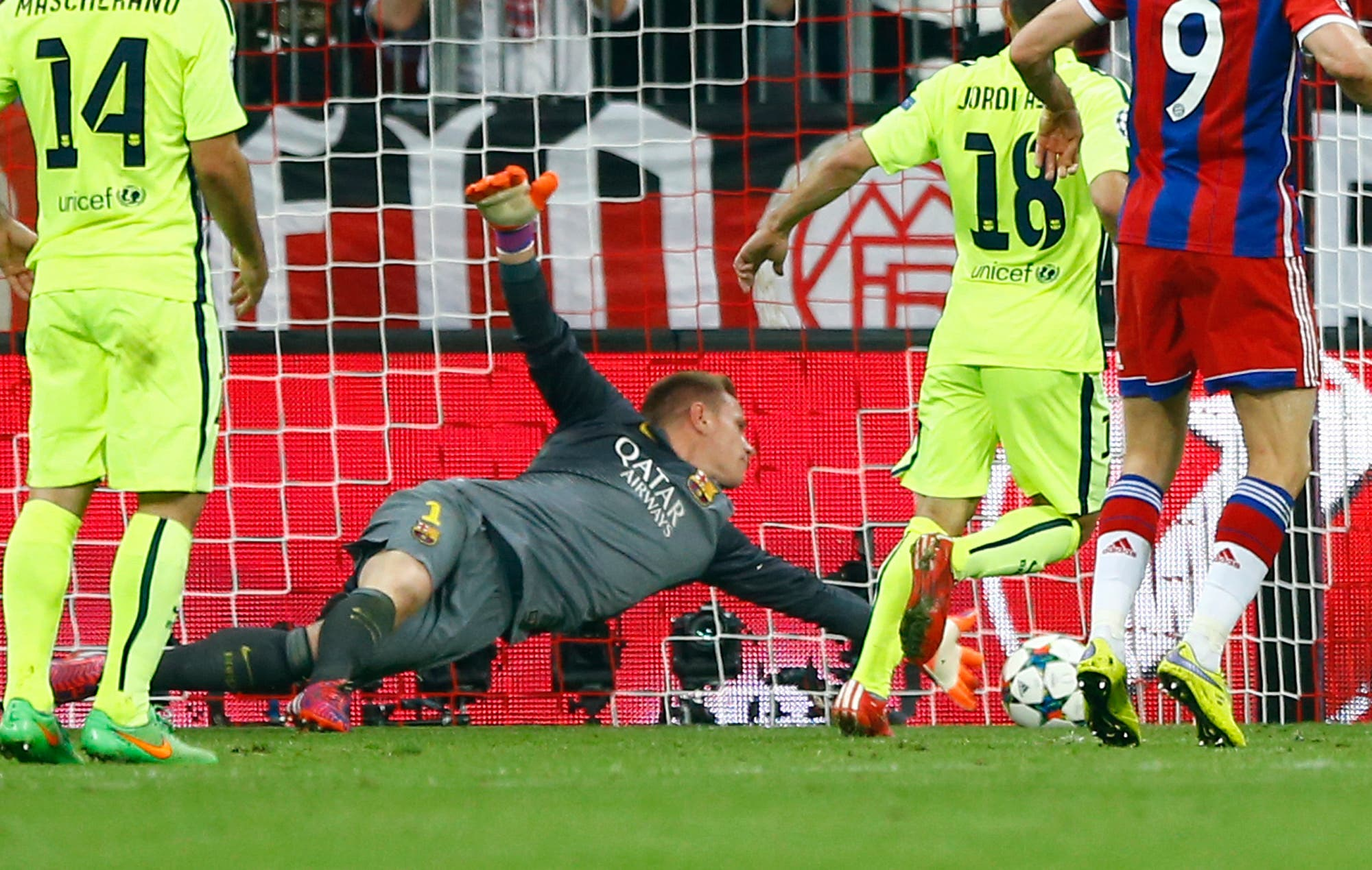 Barcelona's goalkeeper Marc-Andre ter Stegen makes a save during the soccer Champions League second leg semifinal match between Bayern Munich and FC Barcelona at Allianz Arena in Munich, southern Germany, Tuesday, May 12, 2015. (AP)