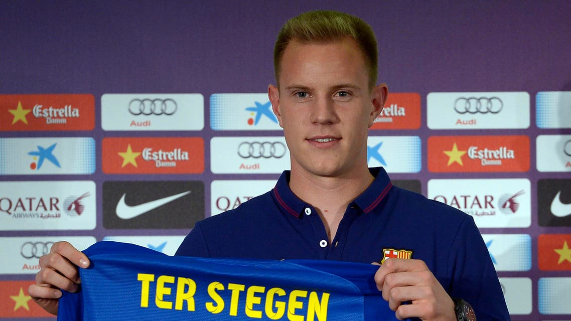 Marc-Andre Ter Stegen, from Germany, holds his new shirt during his official presentation as new goalkeeper of FC Barcelona at the camp nou stadium in Barcelona, Spain, Thursday, May 22, 2014. (AP)