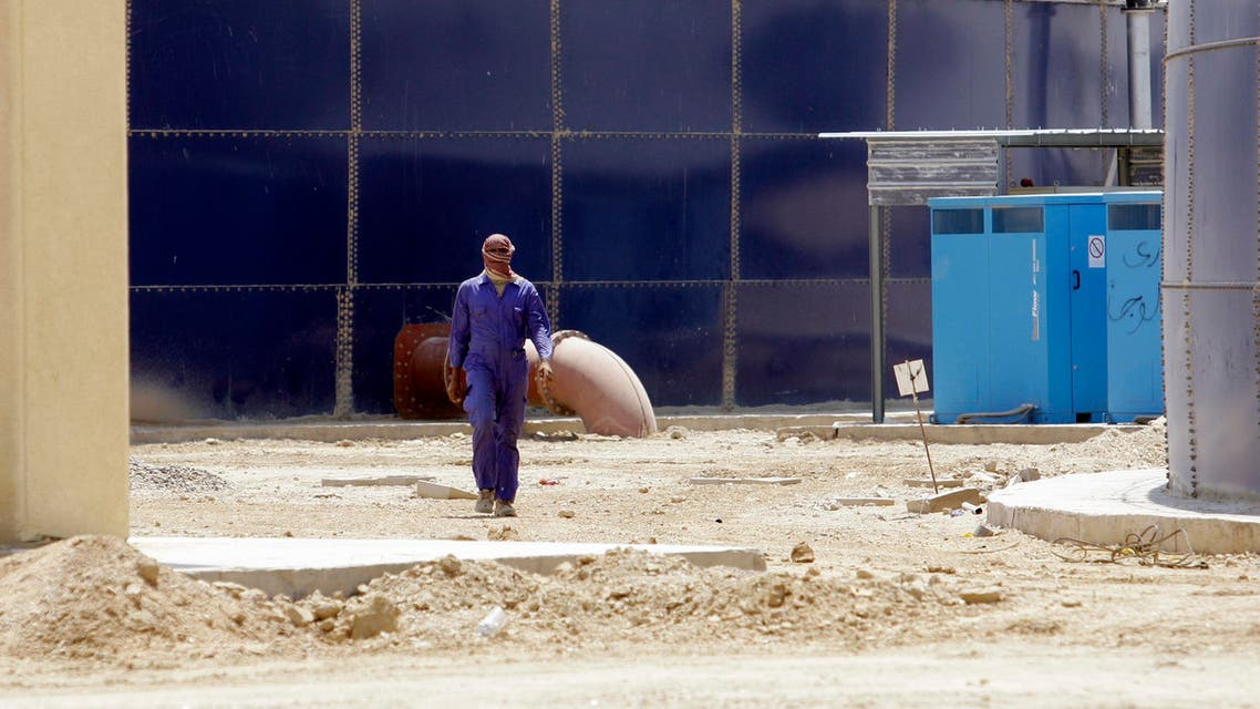 a worker walks through the nearly-complete waste water treatment site in Fallujah, Iraq. (File: AP)