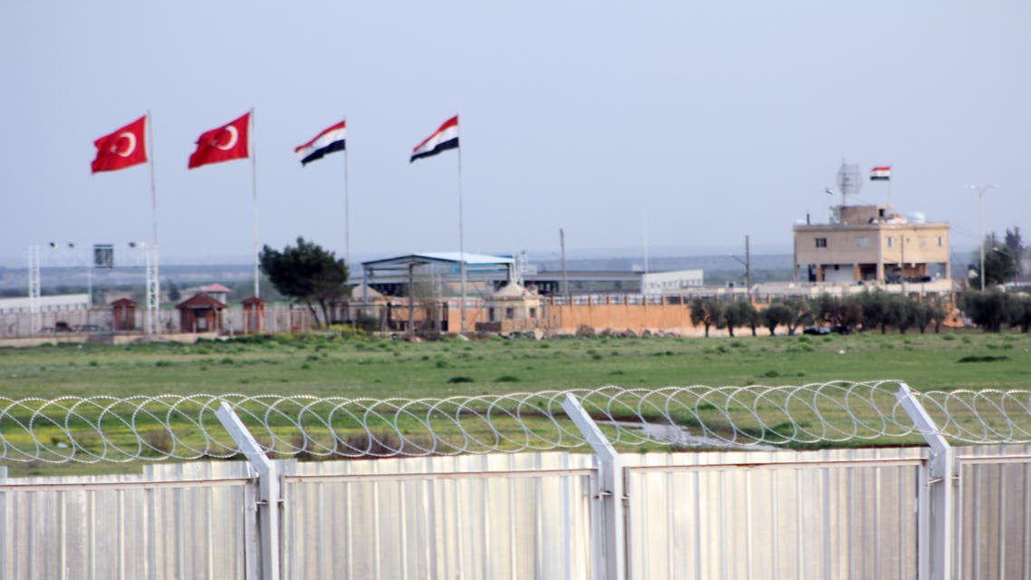 """In this photo taken Tuesday, April 10, 2012, the border crossing between Turkey and Syria is seen from a refugee camp near the border, in Kilis , Turkey. Turkey's prime minister accused Syria of infringing its border and said Tuesday that his country is considering what steps to take in response, including measures """"we don't want to think about."""" (AP Photo/Germano Assad)"""