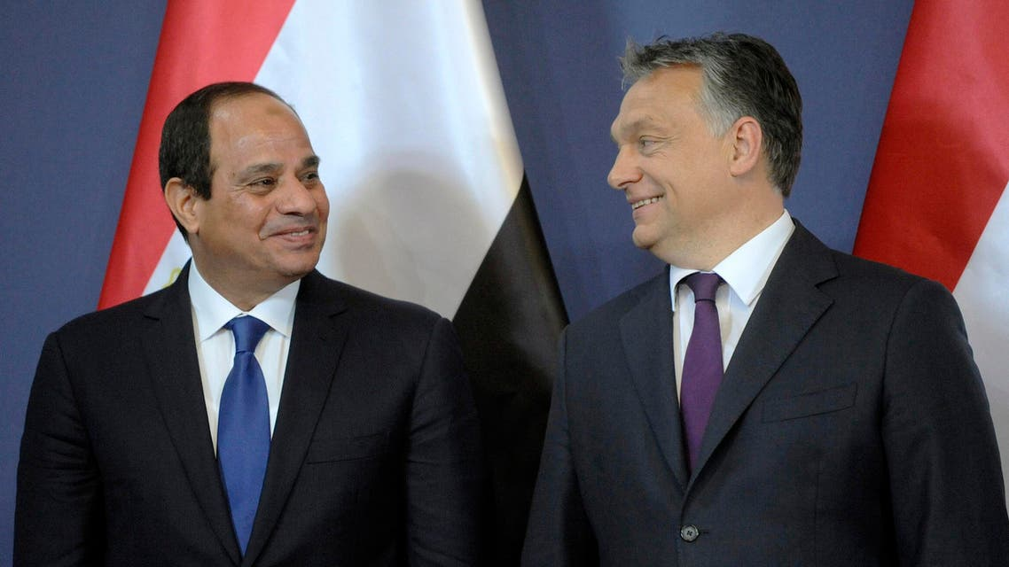 Egyptian President Abdel Fattah el-Sissi, left, and Hungarian Prime Minister Viktor Orban share a smile during a signing ceremony in the Parliament building in Budapest, Hungary, Friday, June 5, 2015. AP