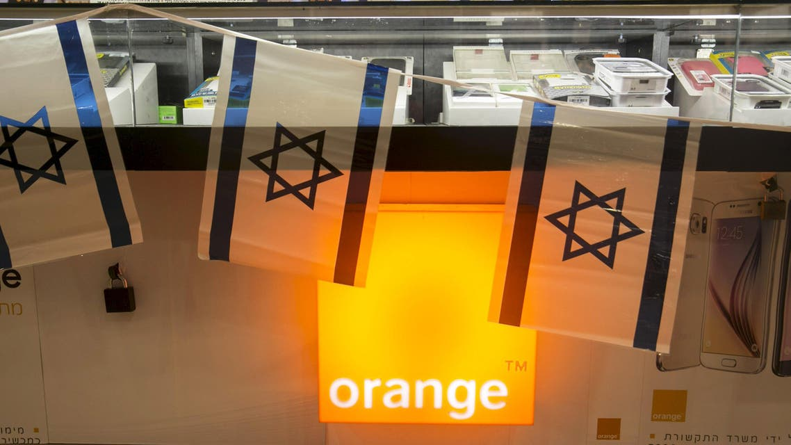 Israeli flags hang over the counter for the Orange mobile company at a mall in Tel Aviv, Israel June 4, 2015. Reuters