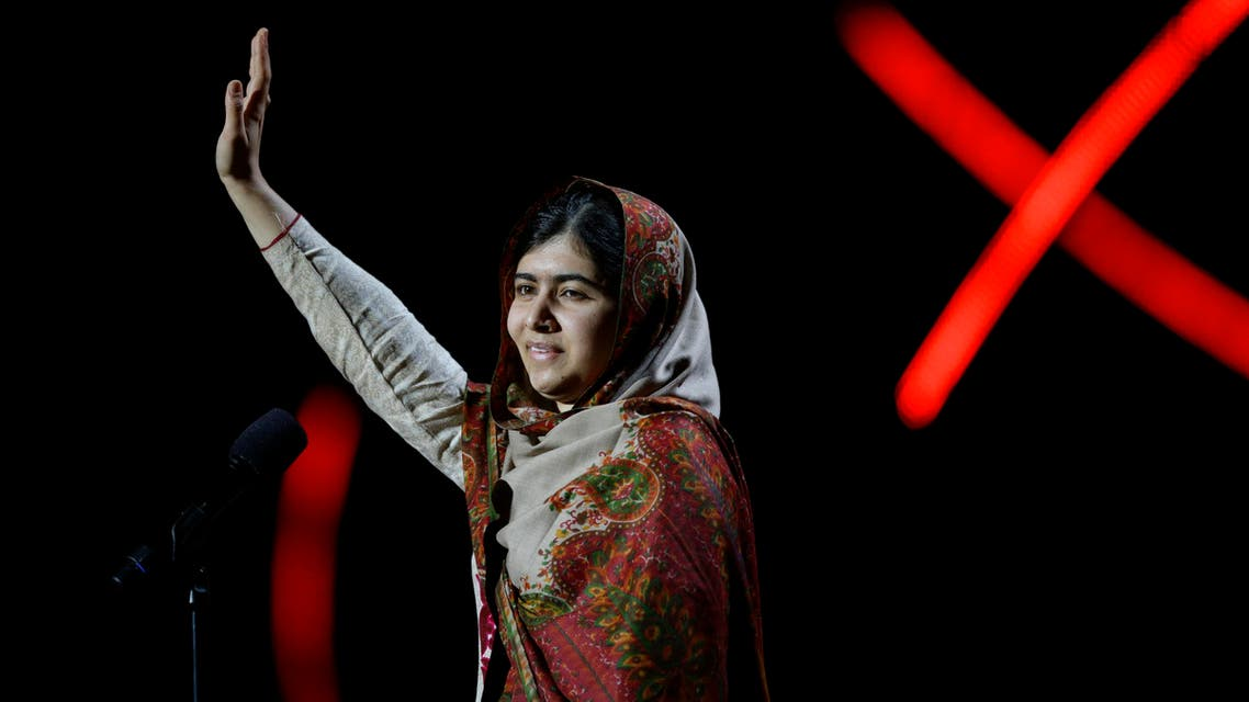 Joint-Nobel Peace Prize winner Malala Yousafzai from Pakistan waves as she arrives to speak on stage during the Nobel Peace Prize Concert in Oslo, Norway, Thursday, Dec. 11, 2014. AP