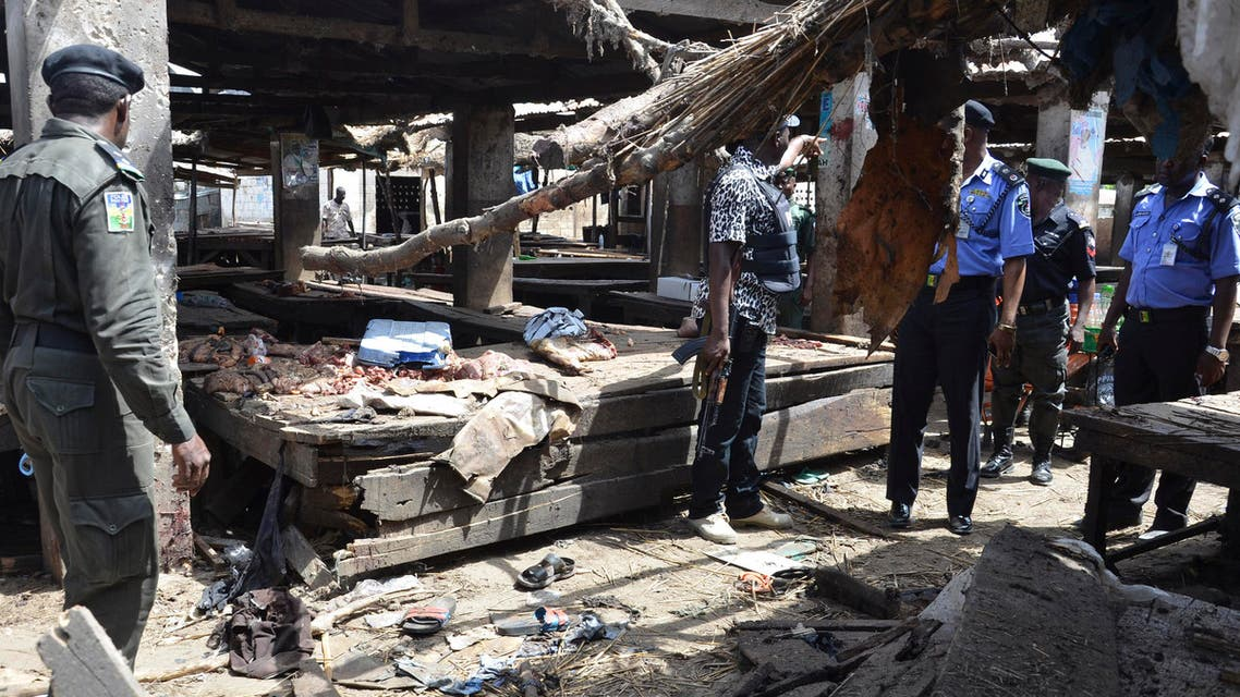 Police officers inspect the site of a suicide bomb attack at a market in Maiduguri , Nigeria, Tuesday, June 2, 2015. AP