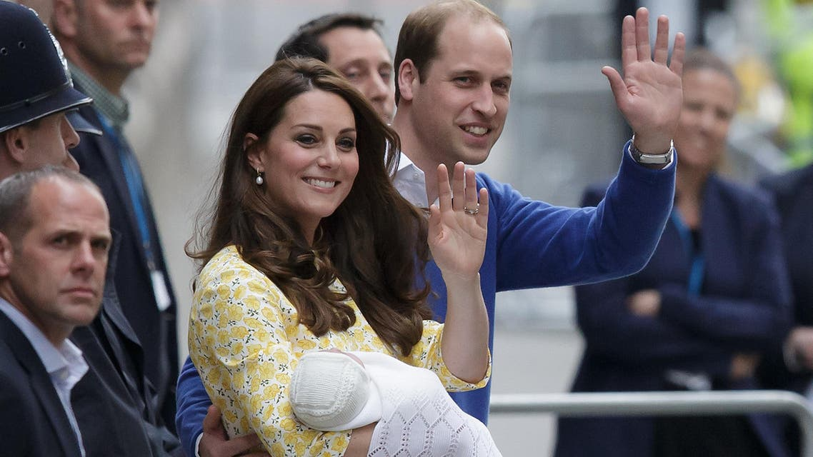 A Saturday, May 2, 2015 photo from files showing Britain's Prince William and Kate, Duchess of Cambridge with their newborn baby, Princess Charlotte Elizabeth Diana, waving to the public as they leave St. Mary's Hospital's exclusive Lindo Wing in London. (File Photo; AP)