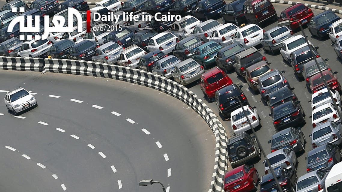A taxi drives near a traffic jam at the 6th October bridge in downtown Cairo. (Reuters)