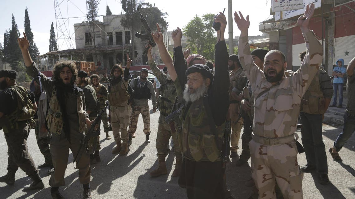 Members of al Qaeda's Nusra Front gesture as they cheer in the northwestern city of Ariha, after a coalition of insurgent groups seized the area in Idlib province. (File: Reuters)