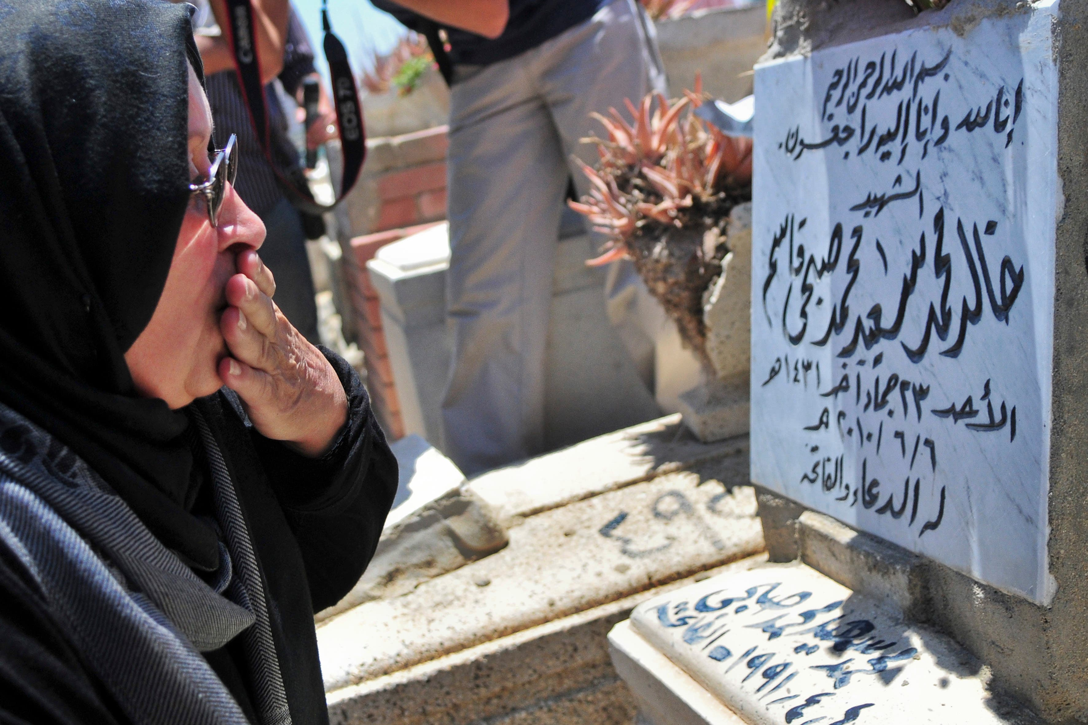 Laila Marzouq, the mother of Khaled Said, visits his grave in Alexandria, Egypt Monday, June 6, 2011. AP
