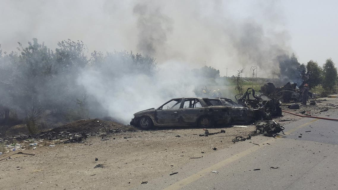 Smoke rises from the site of a car bomb attack on the outskirt of Diyala province May 24, 2015. (AP)