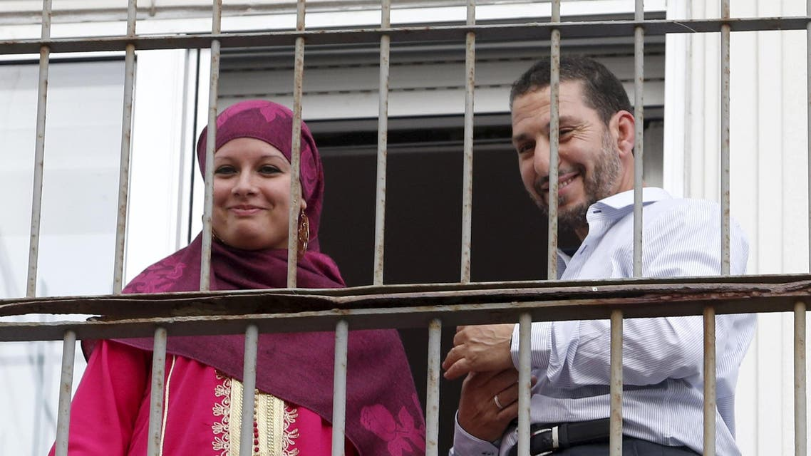 Former Guantanamo detainee Abdul Bin Mohammed Abis Ourgy from Tunisia and his wife Roma Blanco pose for the media on the balcony of his apartment after getting married, in Montevideo. (Reuters)