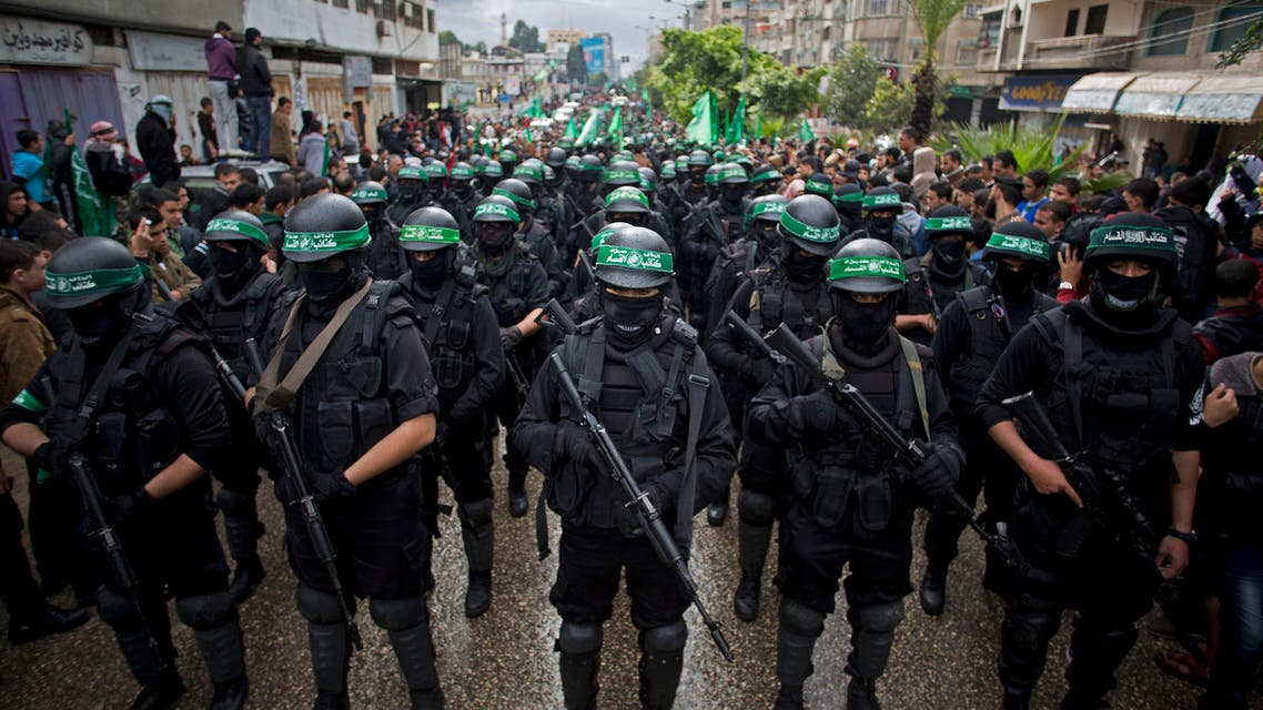 In this Dec. 14, 2014 file photo, masked Palestinian Hamas gunmen perform their military skills during a rally to commemorate the 27th anniversary of the Hamas militant group, in Gaza City AP