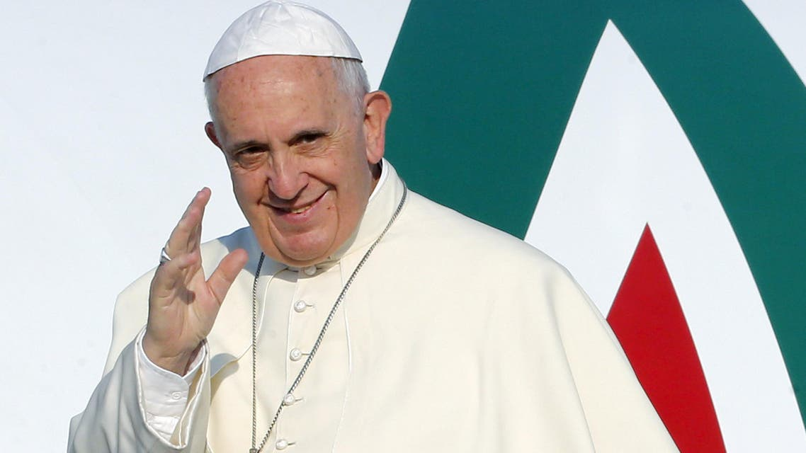 Pope Francis waves as he boards a plane at Fiumicino airport in Rome. (Reuters)