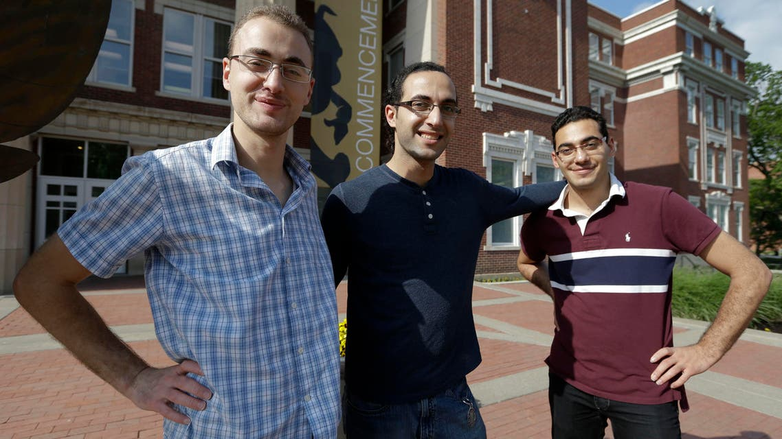 Syrian brothers Mohammad Kayali, left, Ebrahim Kayali, right and Molham Kayali, center, pose for a photograph on the Emporia State University campus in Emporia, Kan. (AP)