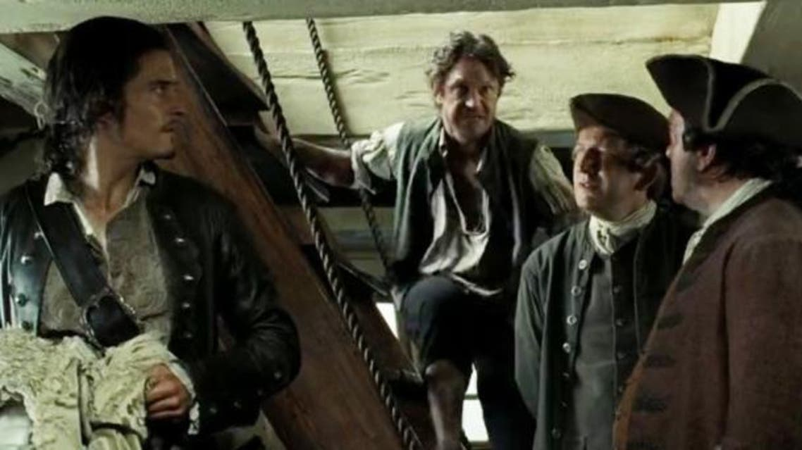Michael Enright, centre, in Pirates of the Caribbean: Dead Man's Chest, as a deckhand aboard The Edinburgh Trader. (National Post)