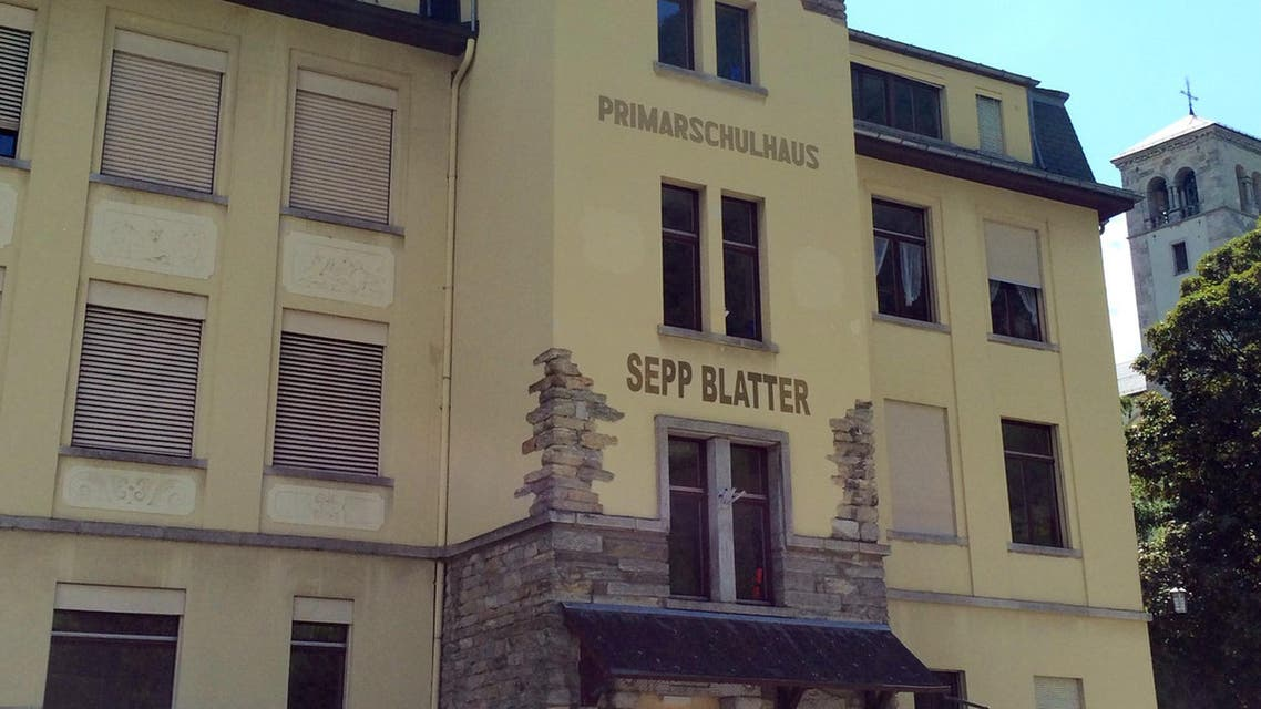 The Primary school in the town of Visp is named after its most renowned citizen, FIFA President Sepp Blatter, who grew up in Visp, Switzerland, in this photo dated Thursday June 4, 2015. Blatter, who has become embroiled in the FIFA corruption scandal and recently announced that he would resign as president, often returns to the picture-postcard town of his youth and where his daughter and son-in-law still live. (AP Photo/Daniella Matar)