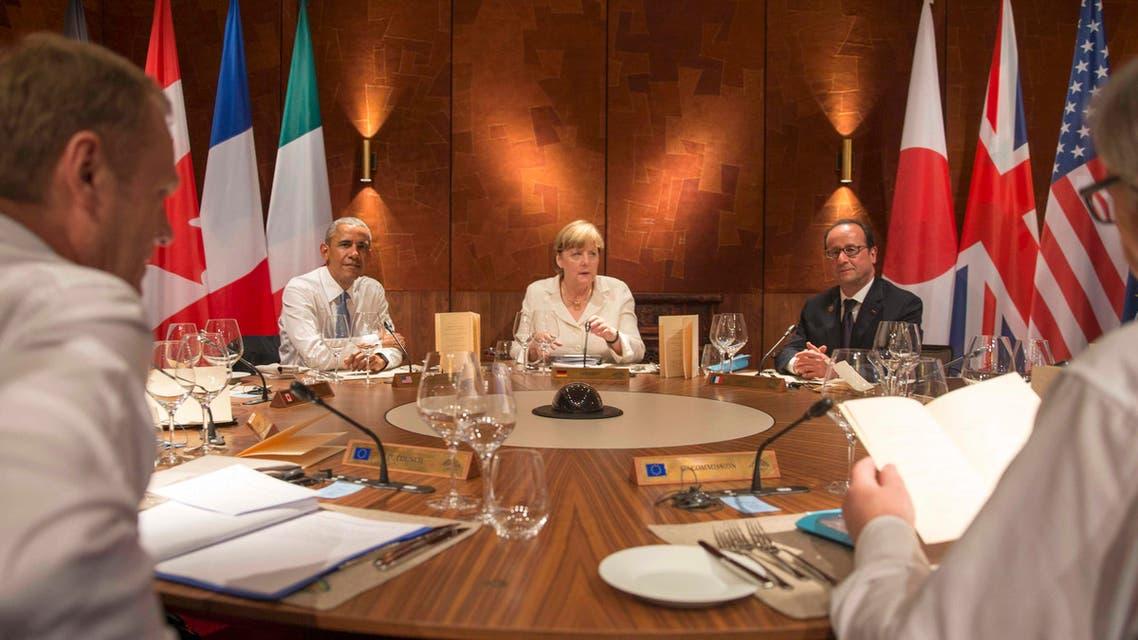 U.S. President Barack Obama, Germany's Chancellor Angela Merkel and France's President Francois Hollande (L-R) attend a working dinner at a G7 summit at the hotel castle Elmau in Kruen, Germany, June 7, 2015.  (Reuters)