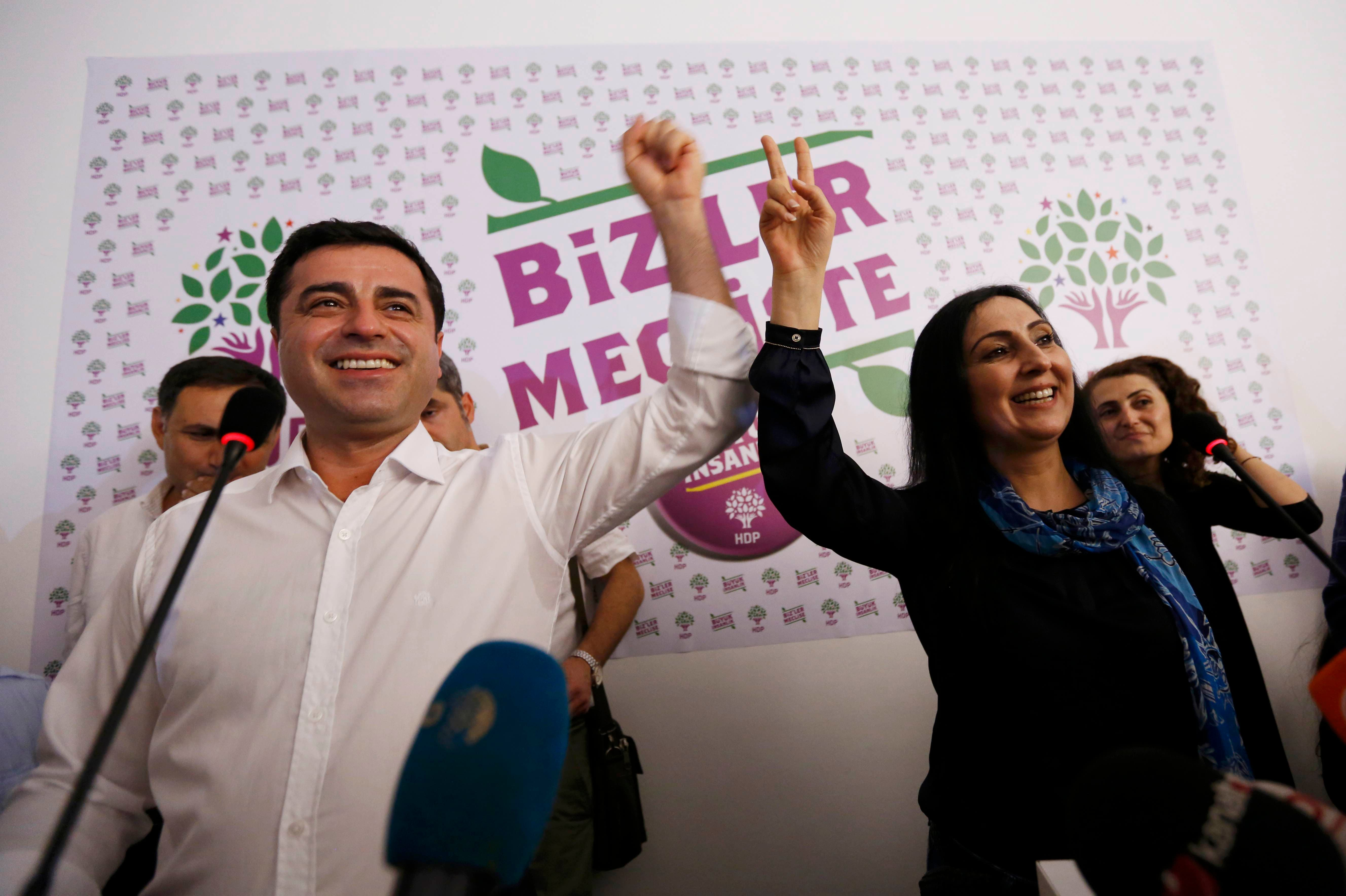 Co-chairs of the pro-Kurdish Peoples' Democratic Party (HDP), Selahattin Demirtas (L) and Figen Yuksekdag celebrate inside party's headquarters in Istanbul, Turkey, June 7, 2015. (Reuters)