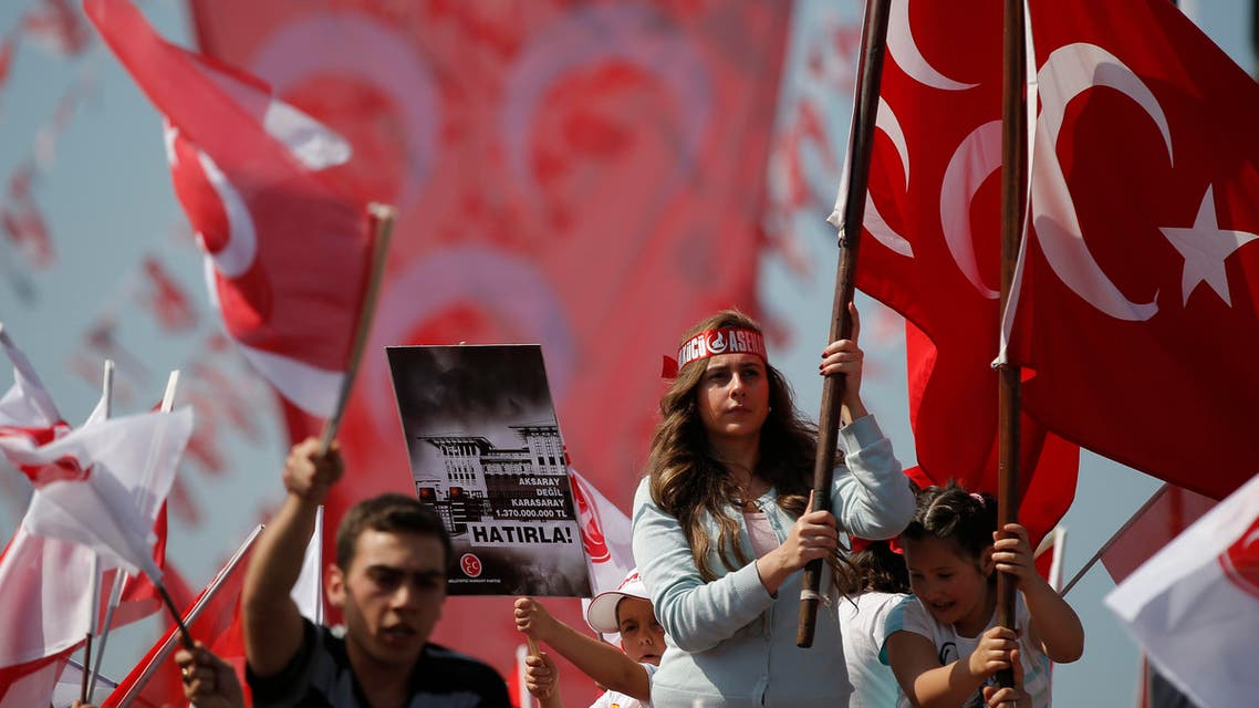 Gray Wolves, the supporters of Turkey's opposition Nationalist Action Party, MHP, cheer MHP leader Devlet Bahceli as he addresses an election rally in Istanbul, Turkey, Sunday, May 31, 2015. AP